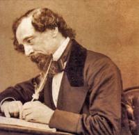 Charles Dickens writing at desk