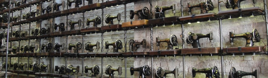 singer sewing machines on brick wall