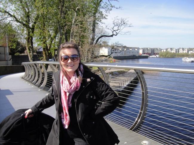 Meredith on Carrick Bridge with suitcase