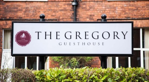 gregory guest house sign