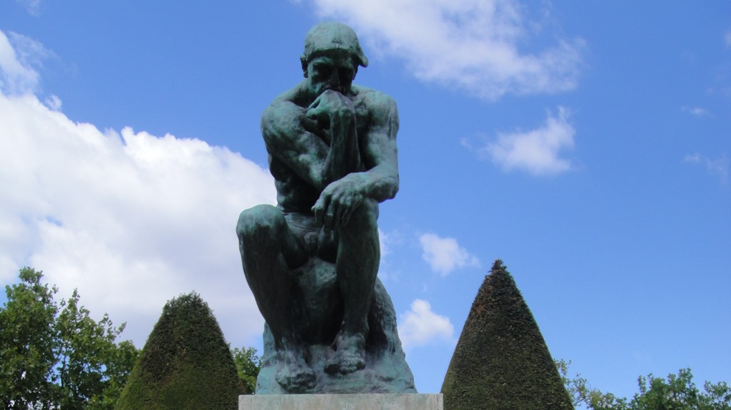 thinking man statue featured