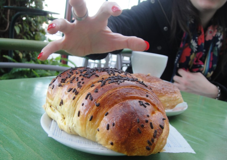 reaching for giant chocolate croissant